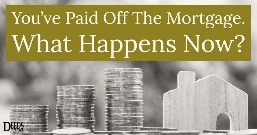 image of money stacked next to a house captioned: You've paid off the mortgage. What happens now?