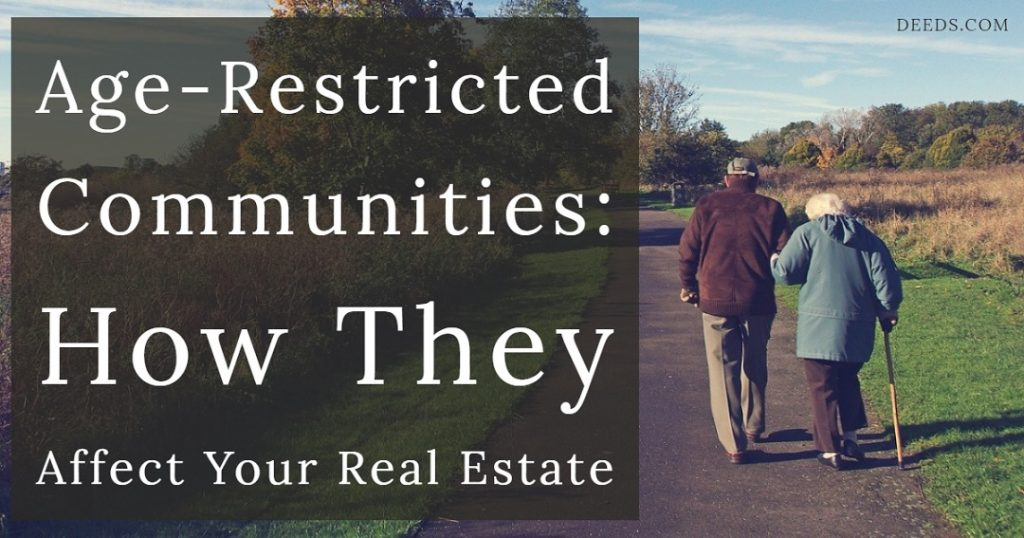 Image of an elder couple walking along a path outside in a rural setting with trees and open areas wearing cool weather clothes holding hands with each other. Captioned: Age-Restricted Communities: How They Affect Your Real Estate