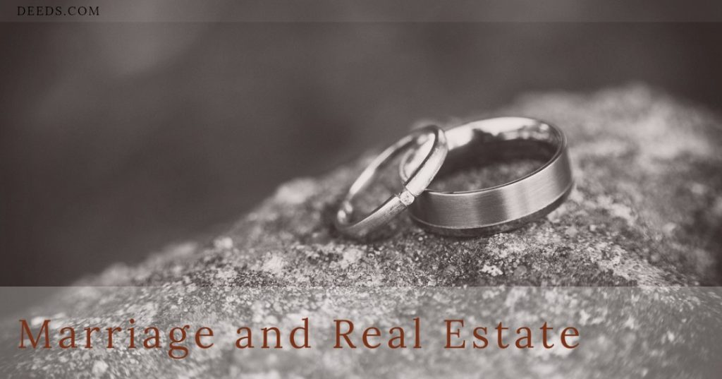 Image of a pair of wedding rings leaned against each other sitting on a rock. Captioned: Marriage and Real Estate