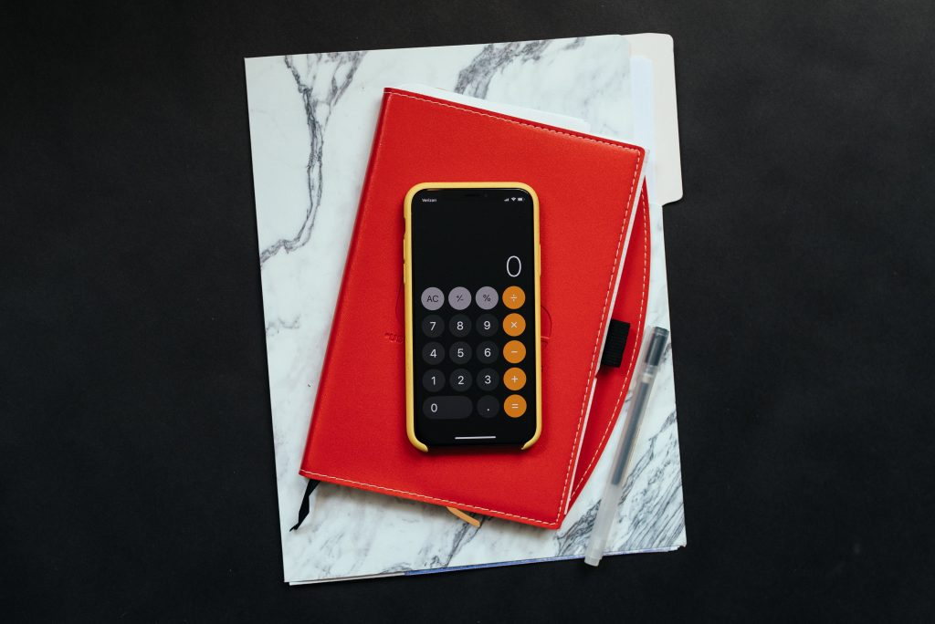 Image of a smart phone being used as a calculator to factor real estate taxes.