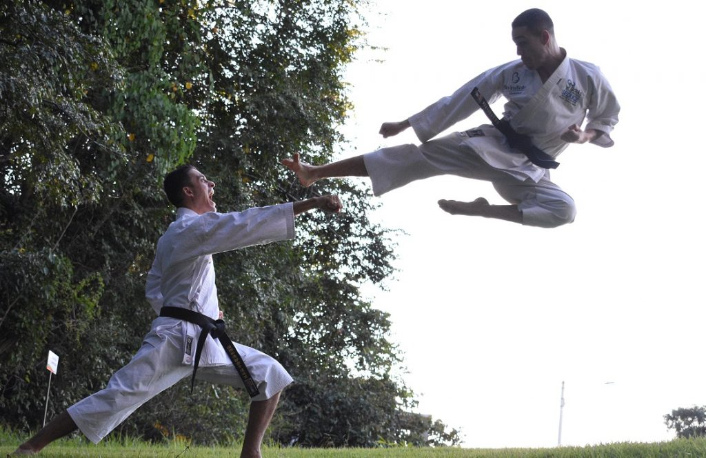 Image of two people practicing martial arts captioned Defending a Quitclaim Deed.