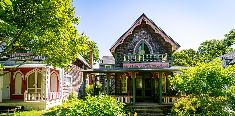 Image of the outside of a very colorful, ornately decorated house in Massachusetts. Captioned: A Quitclaim Deed In Massachusetts, No Problem.