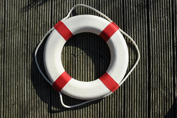 Image of a life preserver laying on a wood floor. Captioned: Chapter 13 was formulated to help people shield their valuables from liquidation and get a fresh start.