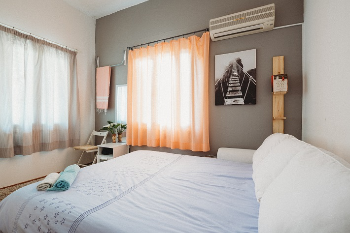 Image of a small bedroom. Captioned: Airbnb: Why It's Hot, How It Works