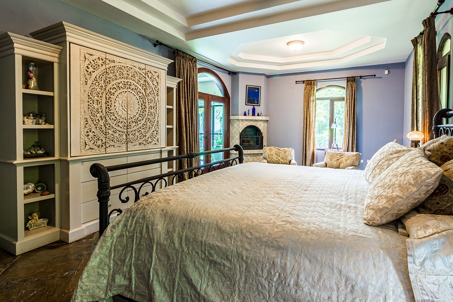 Image of a well appointed bedroom in what is likely a fancy house. Captioned: Real Estate Tax Changes Could Be Coming: Spotlight on Capital Gains and the Stepped-Up Cost Basis