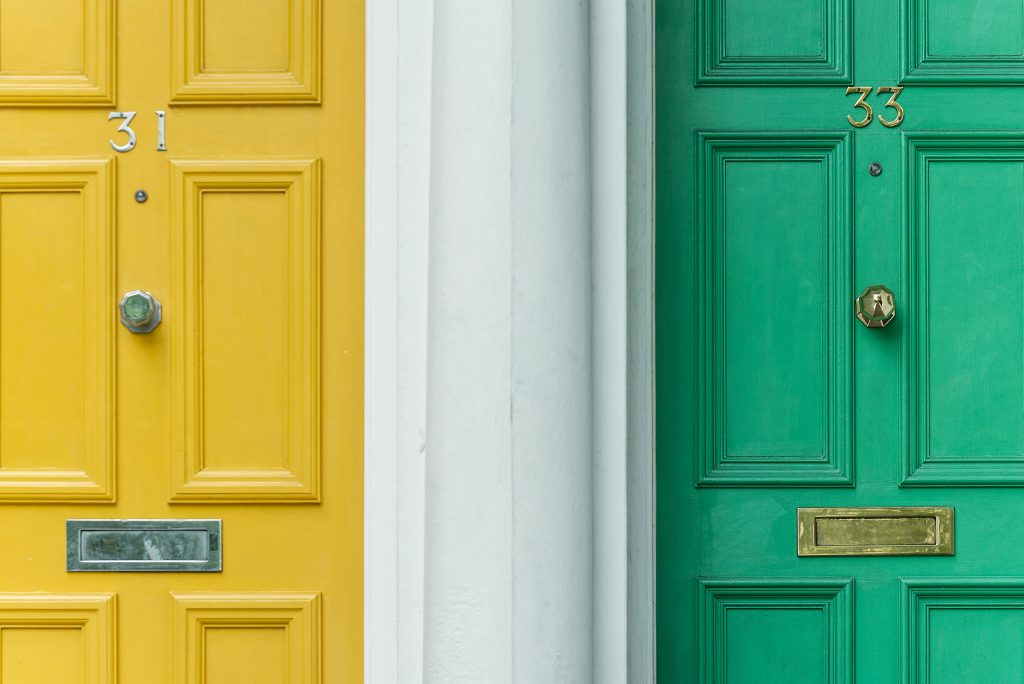 Image of two colorful doors on a house.