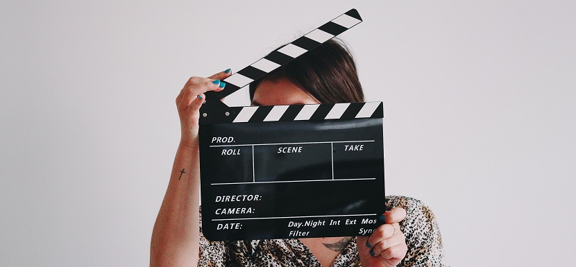 Image of a person holding a moving board. Captioned: On Stage and Behind the Scenes in a Mortgage