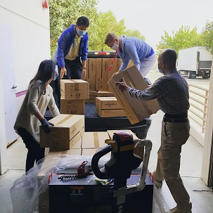 Image of people loading boxes on to a truck.