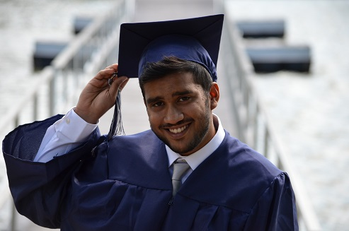 Image of a person in a graduation costume.