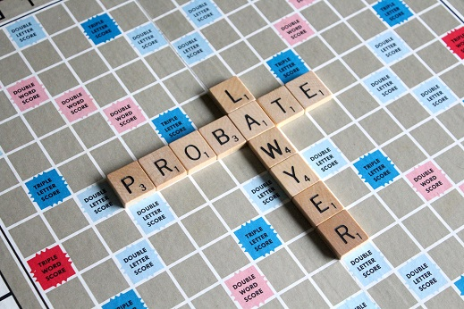 Picture of a game board with letter tiles spelling out the words probate and lawyer.