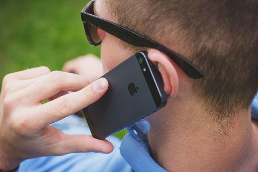 Image of a person talking on a cell phone.