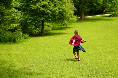 A person frolicking in an open green space with some trees in the background. Captioned: The Partial Release of Mortgage