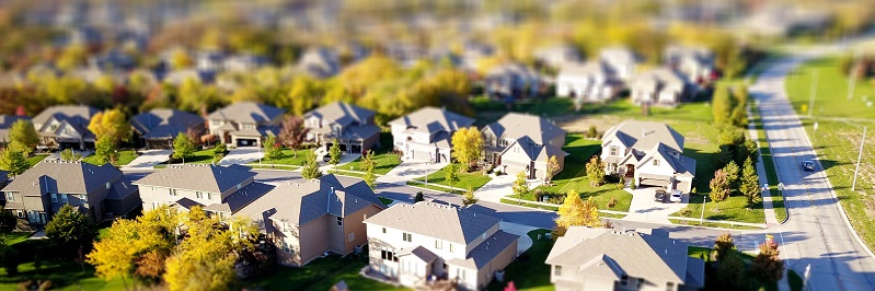 Aerial view of a suburban housing neighborhood. Captioned: Real Estate Legal Descriptions for Deeds