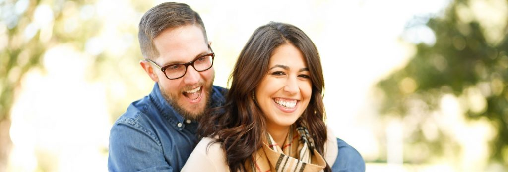 Image of a married couple looking very happy about their first quitclaim deed... real estate.