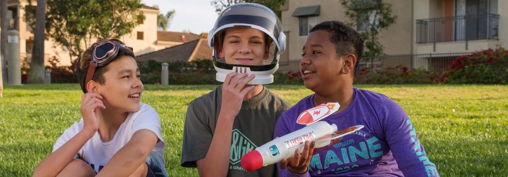 Image of three kids pretending to be space explorers. Captioned: Extraterrestrial Real Estate, Is a Lunar Deed Legit?