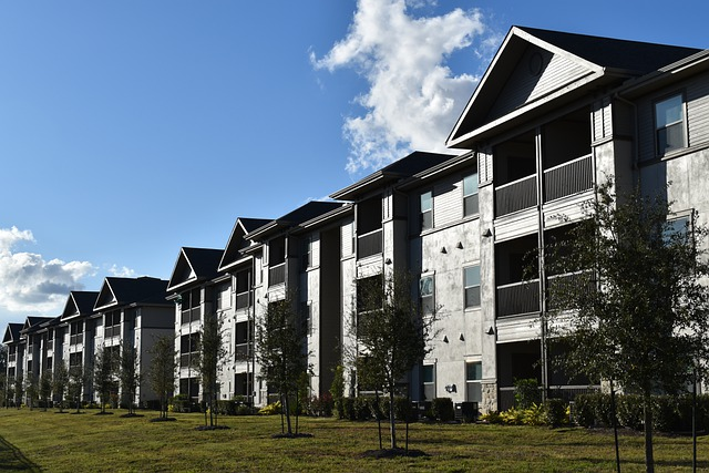 Image of the outside of a row of condominiums. Captioned: Solving the Affordability Problem
