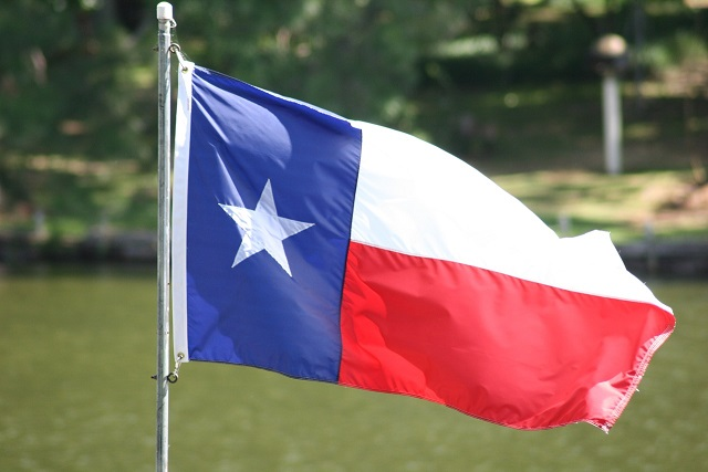 Texas Flag, outside blowing in the wind.