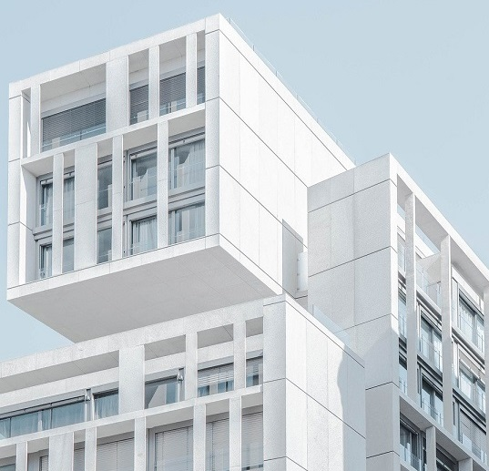 Image of a modern looking modular building. Captioned: Blockchain and the Mortgage Loan