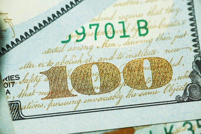 Image of the corner of a one hundred dollar bill, U.S. currency. Captioned: Washington State Deed Recording Fees Just Went Up.