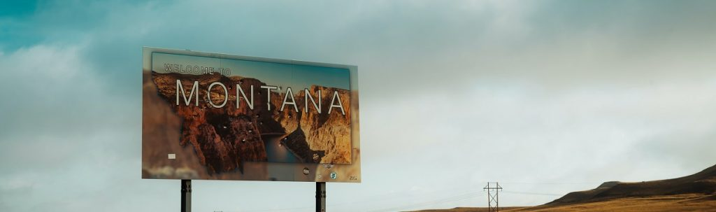 Image of the welcome to Montana sign. Captioned: Montana Property Taxes