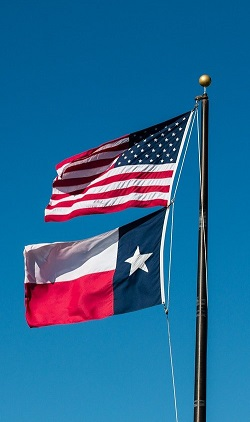 Image of the American Flag and the Texas Flag.